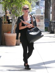 Ashlee Simpson topped off her outfit with a black leather moto jacket.