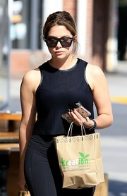 Ashley Benson kept her eyes hidden behind a pair of square sunglasses by Givenchy while grabbing juice in Beverly Hills.