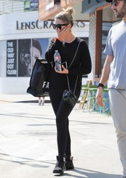 Ashley Benson completed her attire with a pair of black Puma Fierce sneakers.