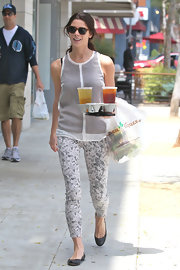 Ashley Greene looked summery on her coffee run wearing these gray floral pants.