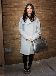 Ashley Greene matched the modern feel of her gray asymmetric coat with a metallic silver Boxer bag.