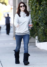 Ashley Greene hit the streets of Hollywood in black knit boots. She paired the low key footwear with a hooded sweatshirt and jeans.