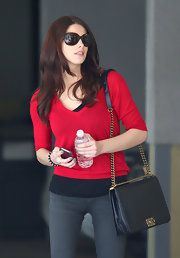 Ashley Greene added the perfect dose of color to her street style with a crimson V-neck sweater.
