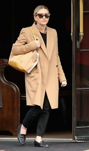 Ashley Olsen stepped out in style sporting a camel-colored wool coat.
