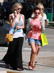 Aly showed off her mustard yellow cross body bag while grabbing some ice cream in Malibu.