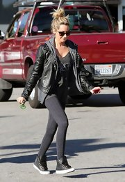 Ashley Tisdale pounded the pavement in a pair of black leather sneakers.