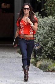 Ashley went for a Western-chic look with an embroidered top, dark denim and a cutout leather belt.