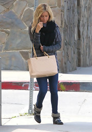 Ashley Tisdale topped off her look with black ankle boots complete with buckled detailing.