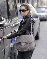 Ashley Tisdale hit the gym with a gray chain-trimmed Chanel bag.