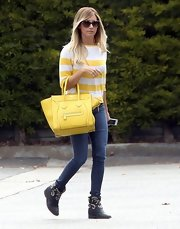Ashley Tisdale chose a bright and flirty yellow sweater look while out and about in Santa Monica.