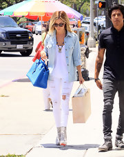 Gotta love the rocker vibe of Ashley Tisdale's skinny white jeans.