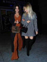 Ashley Tisdale looked striking in black-and-white stripes while headed to Selena Gomez's concert.