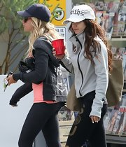"Vanessa Hudges sported an old-school trucker-style hat with crystal-embellished ""faith"" lettering."