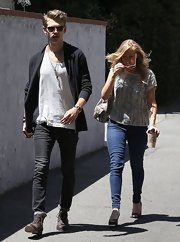 Austin Butler chose a pair of black skinny jean and a cardigan for his look while out with a friend in LA.