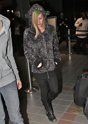 Avril Lavigne made her way through LAX wearing black leather motorcycle boots.