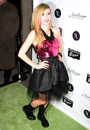 Avril Lavigne celebrated her album launch in classic black leather combat boots.