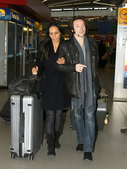 Barbara Becker was spotted at the Berlin Airport wearing a black trenchcoat.
