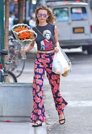 Behati Prinsloo's floral pants gave her look a hippie vibe.