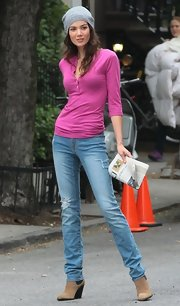 Sheila Marquez posed for a Victoria's Secret photo shoot in a fuchsia henley and jeans.