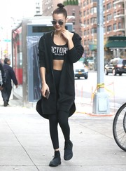 For her footwear, Bella Hadid chose a pair of plain black sneakers.