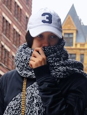 Bella Hadid kept a low profile with a white baseball cap and a knit scarf while out and about in New York City.