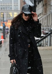 Bella Hadid accessorized with a black leather baseball cap and a pair of square shades while out in New York City.