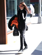 Bella Hadid was seen out in New York City looking athletic in a black-and-white track jacket by Brashy Studios.