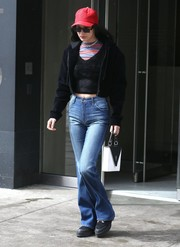 Bella hadid finished off her casual look with a pair of Joe's bootcut jeans.