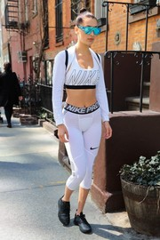 Bella Hadid topped off her sexy-sporty look with a white shrug sweater.