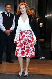 Bella Thorne departed her New York City hotel wearing a charming red and white floral skirt by CH Carolina Herrera.
