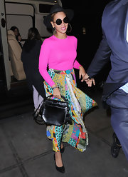 Beyonce carried this black multi-strap bag with her colorful ensemble in NYC.