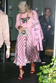 Beyonce Knowles topped off her pink outfit with a studded leather jacket.