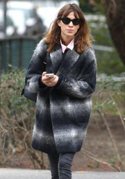 Alexa Chung accessorized with sporty-chic oval sunnies while out on a stroll in New York City.