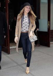 Blake Lively teamed her jeans with a classic beige wool coat.