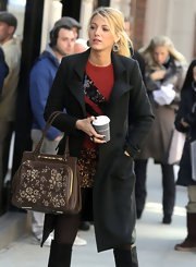 Blake Lively filmed scenes for 'Gossip Girl' toting a chocolate leather Demetra bag embroidered with flowers.