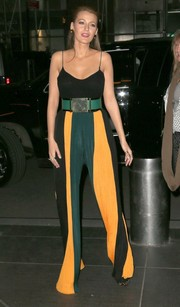 Blake Lively wore these color-blocked palazzo pants from Balmain's Fall 2015 collection while out and about in New York City. She paired the bright pants with a wide belt and a black bodysuit.