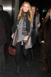 Blake Lively looked chic in Chanel tweed ankle boots. The purple offset the gray and black color scheme of her outfit.