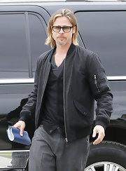 Brad Pitt kept things simple in a gray bomber jacket and matching pants.