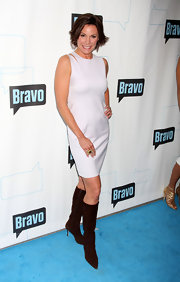 """RealHosue Wife"" LuAnne showed off her classic style at the Bravo party wearing a white sleeveless dress and suede brown boots."