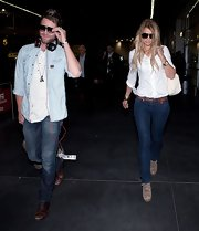 Vogue Williams kept her jeans just where she wants them in a handsome rich-colored belt as she arrived in Melbourne's airport.