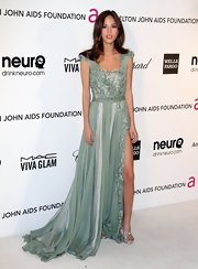 Kelsey Chow opted for a soft and ethereal look at the Elton John Oscar bash with a green draped dress with embroidered petal and pearl detailing.