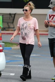 It may be springtime, but Britney Spears isn't saying goodbye to her black sheepskin boots with gray fur trim.