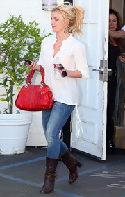 Britney Spears added some spunk to her look with brown leather boots.