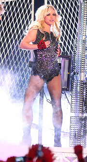 Britney Spears paired her sequin body suit with bold red gloves with jewel detailing.