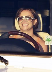 Britney Spears smiles in a pair of modified aviators while driving in Los Angeles.