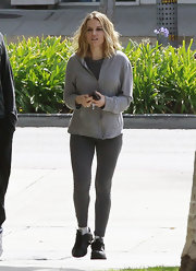 Brooke Mueller looked ready to hit the gym in charcoal leggings and a gray hoodie.
