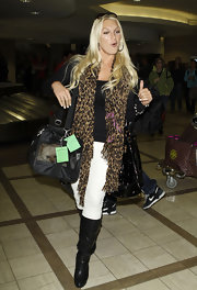 Brooke Hogan strolled through LAX in a pair of slouchy leather boots. She donned the black boots with white skinny jeans and an on trend leopard print scarf.