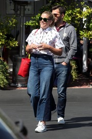 Busy Philipps grabbed lunch looking geek-chic in a short-sleeve print shirt buttoned all the way up to her neck.