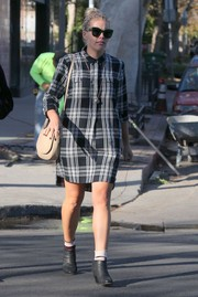 Busy Philipps' black ankle boots and plaid dress were a grunge-chic pairing.