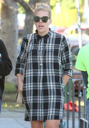 Busy Philipps went shopping in West Hollywood rocking a funky pair of green-rimmed cateye sunnies.